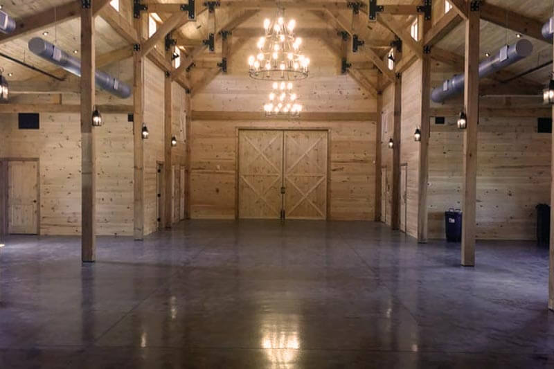 windy hill wedding and event barn interior empty with polished floor